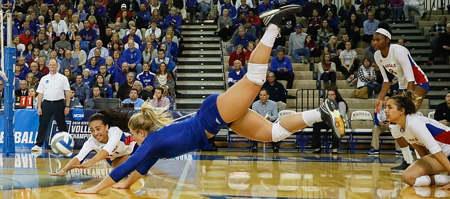 Kansas setter Anise Havili (11), left, and Kansas libero Cassie Wait (5) dive for an attempted dig during the Jayhawks three-set sweep against Samford University in the first round of the NCAA women's volleyball tournament Thursday, Dec. 1, at Horejsi Family Athletics Center.