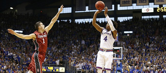 Kansas guard Devonte' Graham (4) pulls up for a three over Stanford guard Christian Sanders (1) during the first half on Saturday, Dec. 3, 2016 at Allen Fieldhouse.