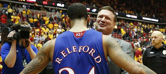 Kansas head coach Bill Self hugs Travis Releford after the Jayhawks' 108-96 win over Iowa State in overtime on Monday, Feb. 25, 2013 at Hilton Coliseum in Ames, Iowa. The win was Self's 500th.