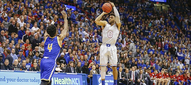 Kansas guard Frank Mason III (0) puts up a three over UMKC guard LaVell Boyd (4) UKMC guard Isaiah Ross (2)during the first half, Tuesday, Dec. 6, 2016 at Allen Fieldhouse.