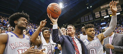 Kansas head coach Bill Self raises up a ceremonial ball commemorating his 600th win as he celebrates with his players and those attending the Jayhawks' 105-62 win over UMKC, Tuesday, Dec. 6, 2016 at Allen Fieldhouse.