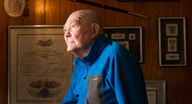 Lawrence veteran Vincent Muirhead, a retired naval commander, was 22 years old when he was stationed on the USS Maryland during the attack on Pearl Harbor on Dec. 7, 1941. Muirhead remembers planning a day of sightseeing before witnessing a Japanese plane flying overhead. He is pictured on Monday, Dec. 5, 2016, in his home.