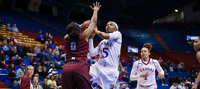 Kansas guard Aisia Robertson (15) goes up for a layup over Harvard's Nani Redford on Wednesday, Dec. 7, 2016 at Allen Fieldhouse.