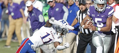 Kansas safety Mike Lee (11) shoves Kansas State quarterback Alex Delton (5) out of bounds on a run during the third quarter, Saturday, Nov. 26, 2016 at Bill Snyder Family Stadium.