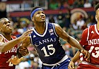 Kansas forward Carlton Bragg Jr. (15) fights for position between Indiana guard Josh Newkirk (2) and Indiana forward Juwan Morgan (13) during the first half of the Armed Forces Classic at Stan Sheriff Center, on Friday, Nov. 11, 2016 in Honolulu, Hawaii.