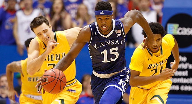 Kansas forward Carlton Bragg Jr. (15) charges up the court with the ball during the second half, Friday, Nov. 18, 2016 at Allen Fieldhouse.
