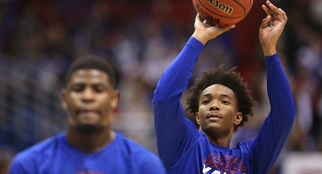 Kansas junior guard Devonte' Graham fires up a shot in pre-game warmups prior to Saturday's matchup against Nebraska at Allen Fieldhouse.