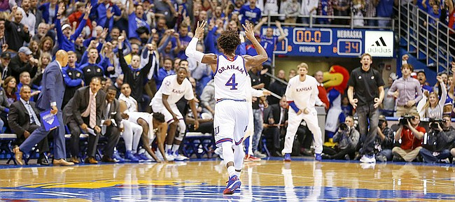 Kansas guard Devonte' Graham (4) turns to the bench after a deep three to end the half against Nebraska on Saturday, Dec. 10, 2016 at Allen Fieldhouse.