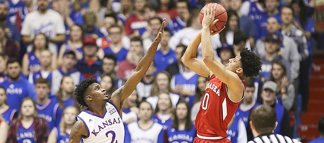 Kansas guard Lagerald Vick (2) defends against a shot from Nebraska guard Tai Webster (0) during the first half, Saturday, Dec. 10, 2016 at Allen Fieldhouse.