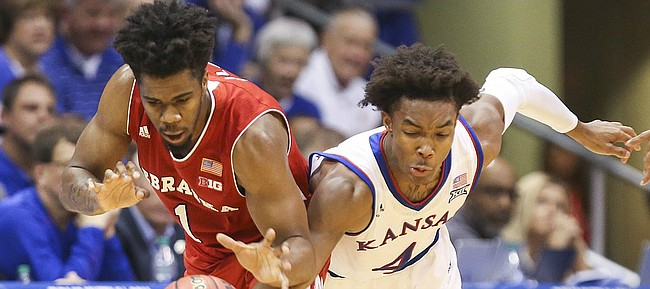 Kansas guard Devonte' Graham (4) pressures Nebraska guard Anton Gill (1) during the second half, Saturday, Dec. 10, 2016 at Allen Fieldhouse.
