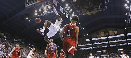 Kansas guard Josh Jackson (11) dunks off of a lob against Nebraska during the second half, Saturday, Dec. 10, 2016 at Allen Fieldhouse.