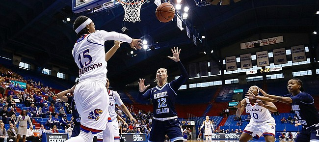 Kansas guard Aisia Robertson (15) makes a pass from beneath the basket in the Jayhawks win against the Rhode Island Rams Sunday, Dec. 11 in Allen Fieldhouse.