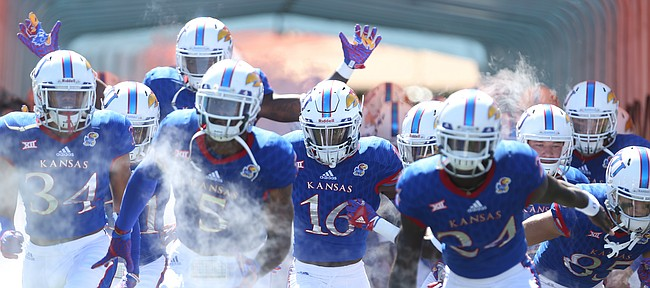 The Kansas Jayhawks take the field on Saturday, Sept. 10, 2016 at Memorial Stadium.
