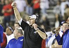 Kansas head coach David Beaty signals a play during the fourth quarter on Thursday, Sept. 29, 2016 at Jones AT&T Stadium in Lubbock, Texas.
