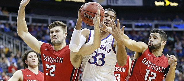 Kansas forward Landen Lucas (33) gets tangled up between Davidson forward Will Magarity (22) and Davidson guard Jack Gibbs (12) going for a loose ball during the first half, Saturday, Dec. 17, 2016 at Sprint Center.