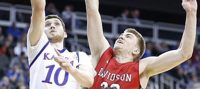 Kansas guard Sviatoslav Mykhailiuk (10) gets in for a bucket past Davidson forward Peyton Aldridge (23) during the first half, Saturday, Dec. 17, 2016 at Sprint Center.