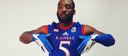 Incoming Kansas defensive end Willie McCaleb poses for photos during a recruiting visit to Lawrence.