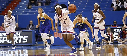 Kansas guard McKenzie Calvert (2) starts a fast break after a steal in the Jayhawks overtime UC Riverside at Allen Fieldhouse Wednesday, Dec. 21.
