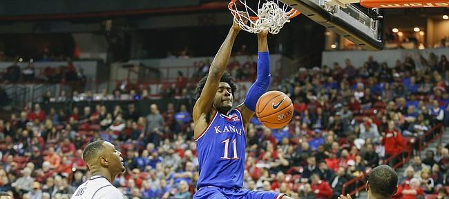 Kansas guard Josh Jackson (11) dunks against UNLV during the first half, Thursday, Dec. 22, 2016 at Thomas & Mack Center in Las Vegas.
