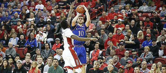 Kansas guard Sviatoslav Mykhailiuk (10) puts a three over UNLV guard Kris Clyburn (1) during the first half, Thursday, Dec. 22, 2016 at Thomas & Mack Center in Las Vegas.