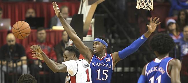 Kansas forward Carlton Bragg Jr. (15) defends against UNLV guard Kris Clyburn (1) during the first half, Thursday, Dec. 22, 2016 at Thomas & Mack Center in Las Vegas.