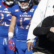 Kansas football coach David Beaty offers instructions to his offense, including LaQuvionte Gonzalez (1), during Saturday's game against Iowa State on Saturday, Nov. 12, 2016.