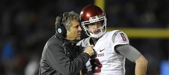 FILE — Washington State head coach Mike Leach, left, talks with quarterback Peyton Bender during the first half of an NCAA college football game against UCLA, Saturday, Nov. 14, 2015, in Pasadena, Calif. Bender transferred from WSU after his redshirt freshman season, and after spending a year with Itawamba Community College, signed with Kansas football. (AP Photo/Mark J. Terrill)