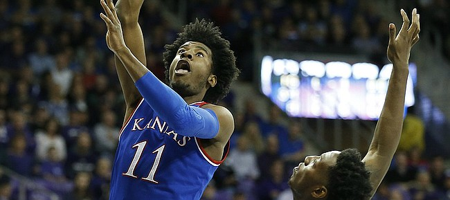 Kansas guard Josh Jackson (11) puts up a shot over TCU forward JD Miller (15) during the first half, Friday, Dec. 30, 2016 at Schollmaier Arena in Fort Worth, Texas