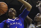 Kansas forward Jada Brown (4) shoots past Baylor forward/center Beatrice Mompremier (32) in the first half of an NCAA college basketball game, Sunday, Jan. 1, 2017, in Waco, Texas.