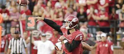 FILE — Washington State quarterback Peyton Bender (6) throws the ball during the second half of an NCAA college football game against Oregon State, Saturday, Oct. 17, 2015, in Pullman, Wash. Bender signed with Kansas in December 2016, as a junior college transfer from Itawamba Community College. (AP Photo/Young Kwak)