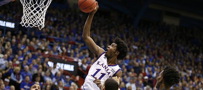 Kansas guard Josh Jackson (11) comes in with a put-back bucket against Kansas State during the first half, Tuesday, Jan. 3, 2017 at Allen Fieldhouse.
