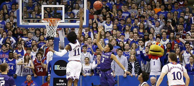 Kansas State guard Kamau Stokes (3) lofts a shot over Kansas guard Josh Jackson (11) during the second half, Tuesday, Jan. 3, 2017 at Allen Fieldhouse.