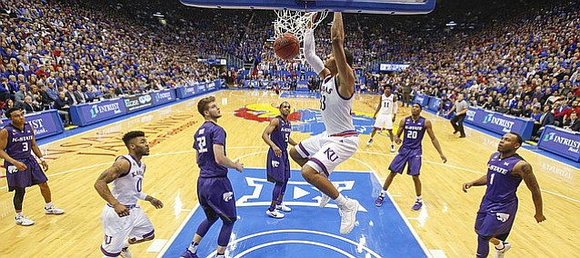 Kansas forward Landen Lucas (33) finishes a dunk against Kansas State late in the second half, Tuesday, Jan. 3, 2017 at Allen Fieldhouse.