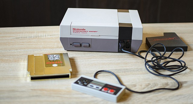 An original Nintendo NES video game system is shown in this stock photo.