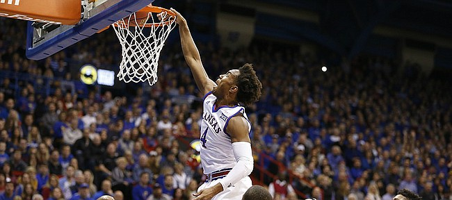 Kansas guard Devonte' Graham (4) puts down a dunk against Texas Tech during the first half, Saturday, Jan. 7, 2017 at Allen Fieldhouse.