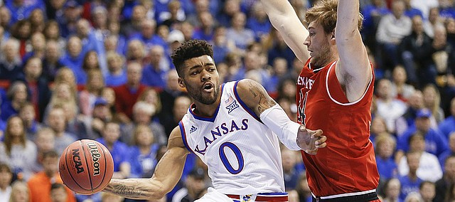 Kansas guard Frank Mason III (0) swoops around Texas Tech forward Matthew Temple (34) to pass during the first half, Saturday, Jan. 7, 2017 at Allen Fieldhouse.