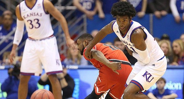 Kansas guard Josh Jackson (11) chases down a ball after knocking it loose from Texas Tech guard Keenan Evans (12) during the first half, Saturday, Jan. 7, 2017 at Allen Fieldhouse.