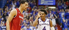 Kansas guard Devonte' Graham (4) celebrates a late, second-half three-pointer next to Texas Tech forward Zach Smith (11) on Saturday, Jan. 7, 2017 at Allen Fieldhouse.