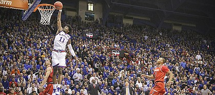 Kansas guard Josh Jackson (11) comes in for a breakaway dunk during the first half against Texas Tech, Saturday, Jan. 7, 2017 at Allen Fieldhouse.