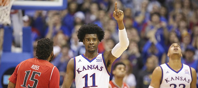 Kansas guard Josh Jackson (11) signals the ball going the Jayhawks' way after a Texas Tech turnover during the second half, Saturday, Jan. 7, 2017 at Allen Fieldhouse.