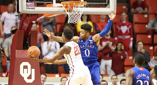 Oklahoma guard Kameron McGusty (20) puts a shot up against Kansas guard Frank Mason III (0) during the first half, Tuesday, Jan. 10, 2017 at Lloyd Noble Center in Norman, Okla.
