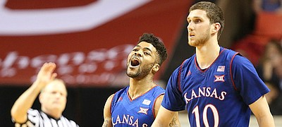 Kansas guard Frank Mason III (0) celebrates an Oklahoma turnover next to Kansas guard Sviatoslav Mykhailiuk (10) during the second half, Tuesday, Jan. 10, 2017 at Lloyd Noble Center in Norman, Okla.