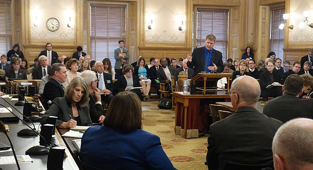 Budget Director Shawn Sullivan outlines Gov. Sam Brownback's budget plan during a packed joint committee hearing of the House tax and budget committees.