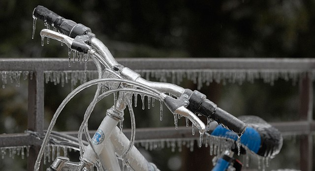 In this file photo from December 2007, icicles cling to a bicycle on the University of Kansas campus.