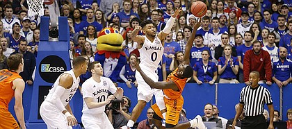 Kansas guard Frank Mason III (0) gets in the face of Oklahoma State guard Jawun Evans (1) on a shot late in the second half, Saturday, Jan. 14, 2017 at Allen Fieldhouse.