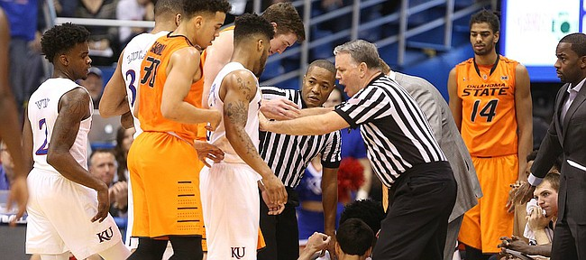 Officials hold both teams back after a flagrant foul on Oklahoma State guard Lindy Waters III (21) during the second half, Saturday, Jan. 14, 2017 at Allen Fieldhouse.