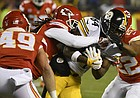 Kansas City Chiefs free safety Ron Parker (38) tackles Pittsburgh Steelers wide receiver Antonio Brown (84) during the first half of an NFL divisional playoff football game Sunday, Jan. 15, 2017, in Kansas City, Mo.