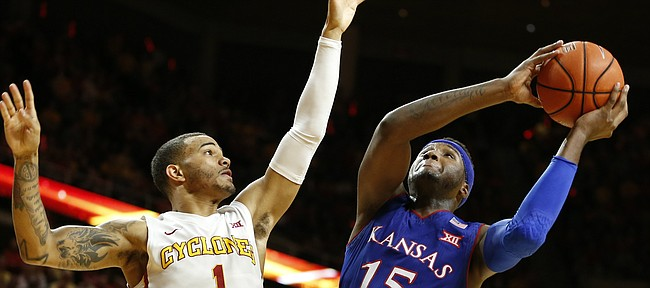 Kansas forward Carlton Bragg Jr. (15) works to get a shot around Iowa State guard Nick Weiler-Babb (1) during the second half, Monday, Jan. 16, 2017 at Hilton Coliseum.
