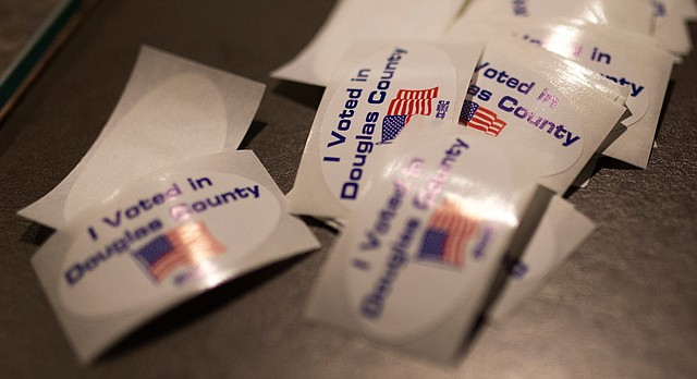 A gathering of stickers along the counter at the Douglas County Courthouse awaited early voters, Nov. 3, 2016.