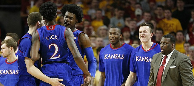 Kansas guard Josh Jackson (11) gives a chest bump to Kansas guard Lagerald Vick (2) after a steal and a dunk during the first half, Monday, Jan. 16, 2017 at Hilton Coliseum.